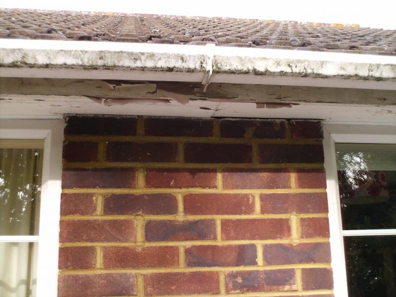 Old boards and guttering to Roofline